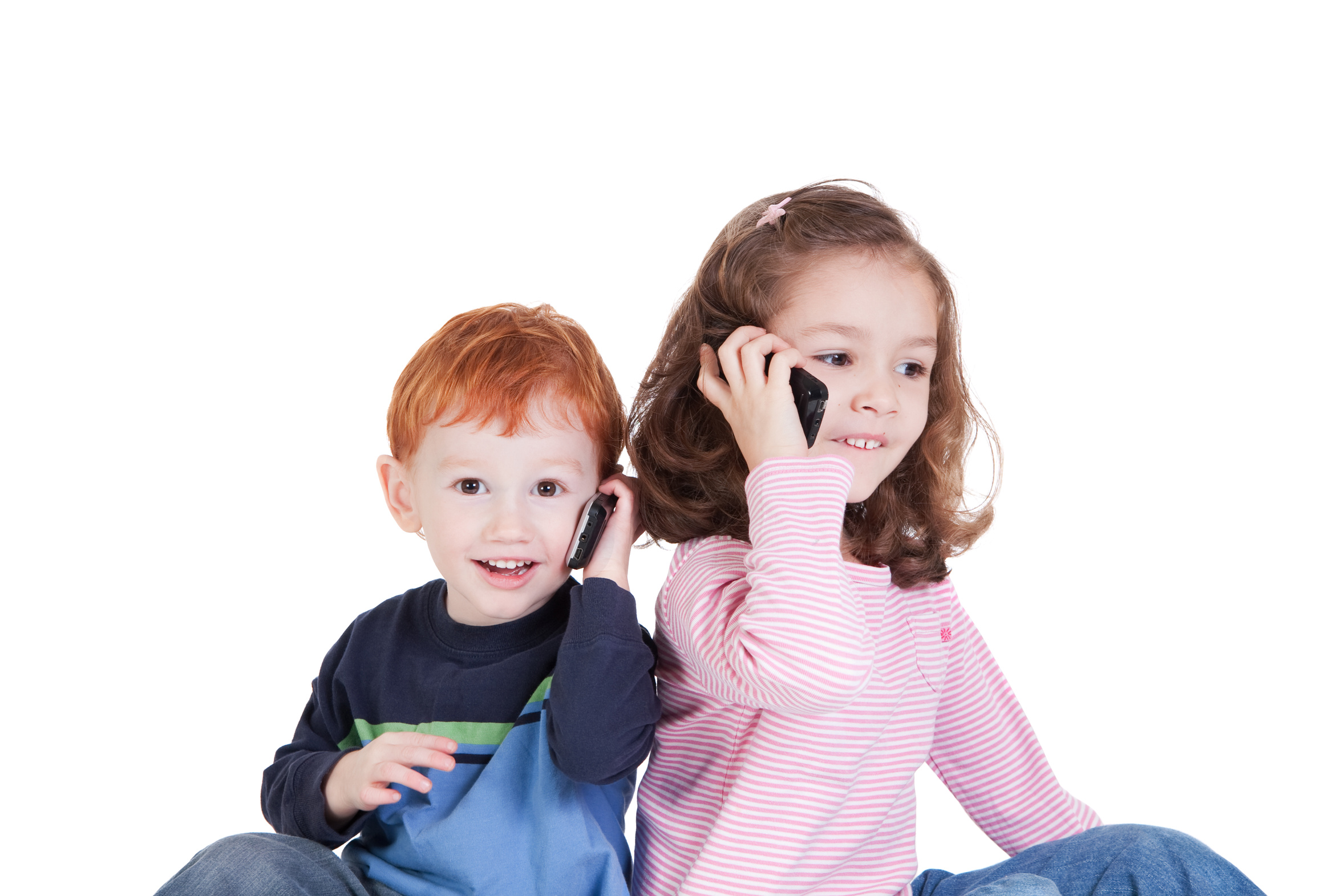 Happy kids on mobile phones