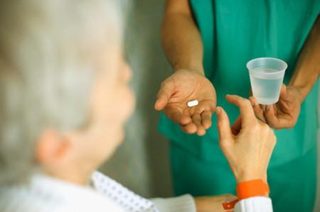 Nurse Bringing Patient His Medication