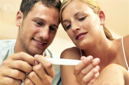 Couple holding pregnancy test