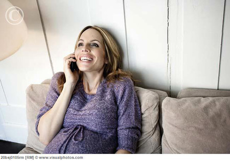 Pregnant woman phoning
