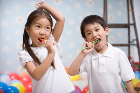 two children brush them teeth  | location: Tokyo Japan | description: two children brush them teeth  | location: Tokyo Japan