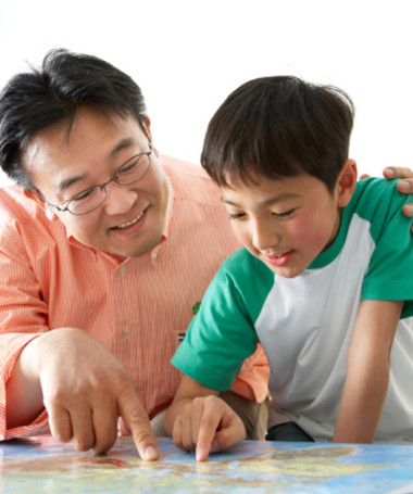 Tokyo,JAPAN. Father and his son are pointing a map and talking.
