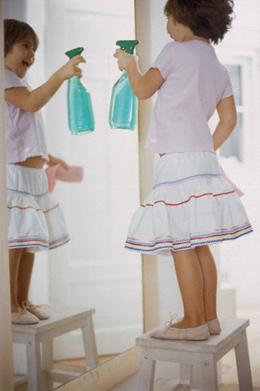 Girl Cleaning Mirror