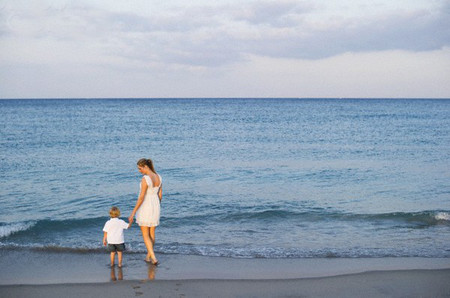 Mother with son (3-4) on beach --- Image by © Rick Gomez/Corbis